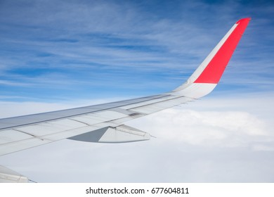 cloud and blue sky of airplane from window