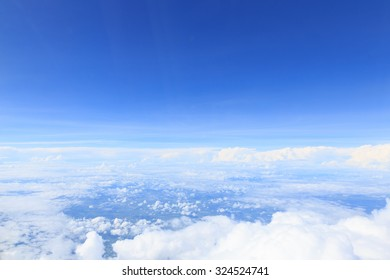Cloud and blue sky from the airplane windows