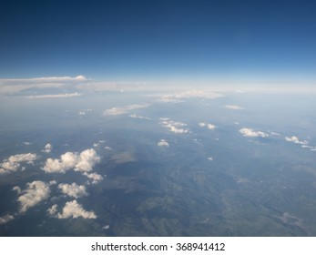 Cloud in blue sky view from aircraft window