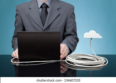 Cloud computing concept. Man send data from laptop to cloud via ethernet cable.