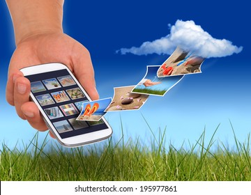 Cloud computing concept. Mini tablet in hand.