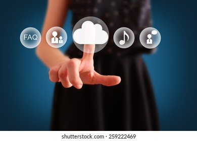 Cloud computing concept. Woman click on cloud icon ahead. Selective focused on finger and cloud