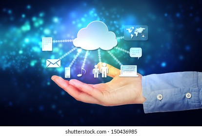 Cloud computing connectivity concept being held in a one persons hand on blue technology background