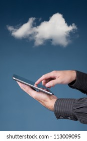 Cloud computing and digital tablet. Man working with digital tablet and cloudscape.