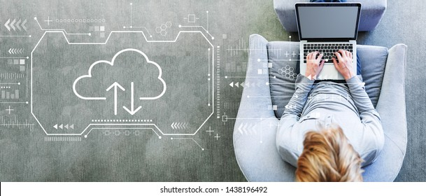 Cloud computing with man using a laptop in a modern gray chair
