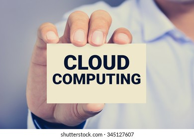 CLOUD COMPUTING message on the card shown by a man