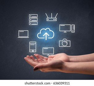 Cloud and computing related icons hovering over young hand