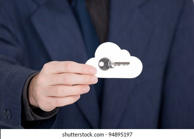 Cloud computing security concept. Hand giving secure cloud with key.