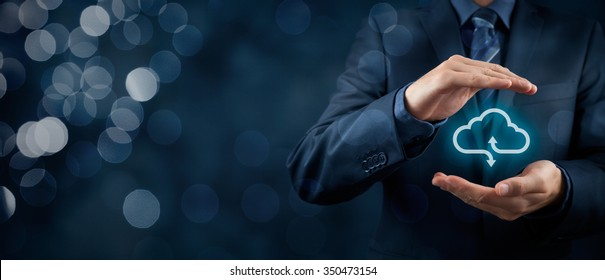 Cloud computing service concept - connect to cloud. Businessman offering cloud computing service represented by icon. Wide banner composition and bokeh in background.