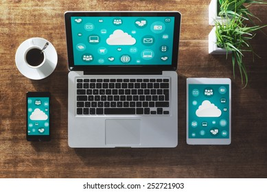 Cloud computing and social network interface on a laptop, tablet and smartphone screen