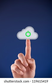 Cloud computing startup concept. Mans hand click on cloud icon with start symbol.