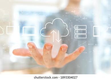 Cloud computing with young man holding his hand