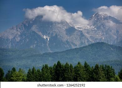 Cloud covered Jezersko Combe and Grintovec highest mountain peak of the Kamnik Savinja Alps Karawanks range of Slovenia near Ljubljana airport