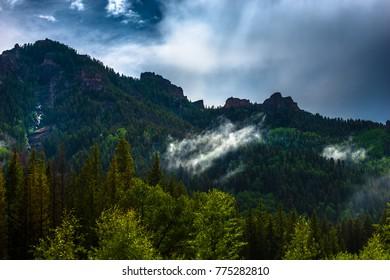 Cloud covered San Juan Mountain ridges east of Ridgeway