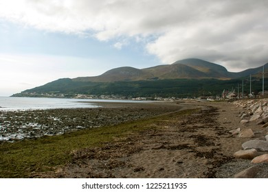 The cloud covered Slieve Donard in the Mourne Mountains seen from Newcastle Beach in County Down Northern Ireland in late December 2014
