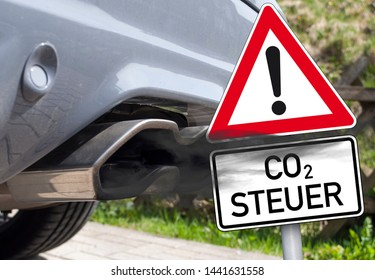 Cloud of exhaust with traffic sign and the german word for co2-tax - co2 Steuer