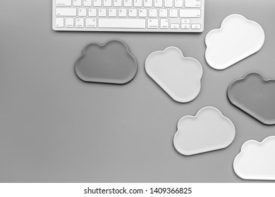 Cloud figures and keyboard for cloud storage on gray background top view mockup