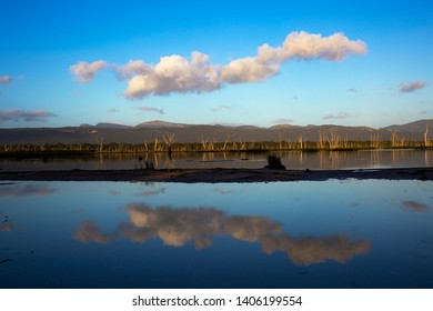 Cloud formation over the Grampians reflected in the mirror smooth waters of Lake Fyans, a freshwater reservoir near the tourist town of Halls Gap, Victoria, Australia.