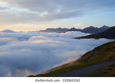 A cloud inversion over the French Pyrenees mountains at sunrise in summer