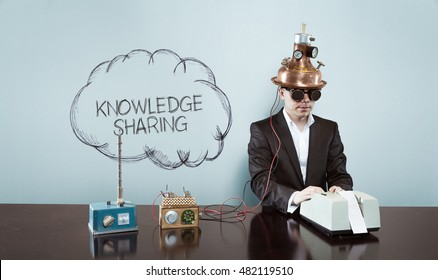 Cloud knowledge sharing text with vintage businessman at office
