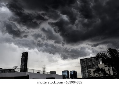 Cloud layer before rain storm is coming above the building in Bangkok city. Dramatic mood scene of view make filling sorrow, sad, gray that not meaning of happy.