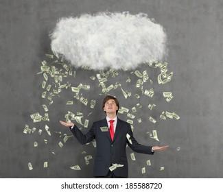 Cloud and money rain. Happy businessman,