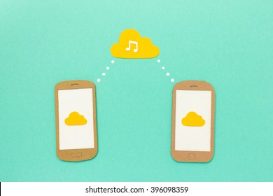 Cloud music concept - two smart phones playing music tracks from cloud service