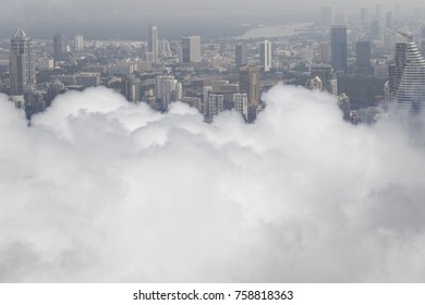 Cloud Over building in Bangkok,Thailand.Strategy concept.Above the clouds.