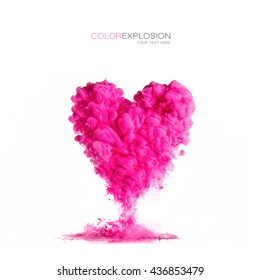 Cloud of pink ink heart shaped isolated on white. Texture of acrylic ink in water. Color explosion.