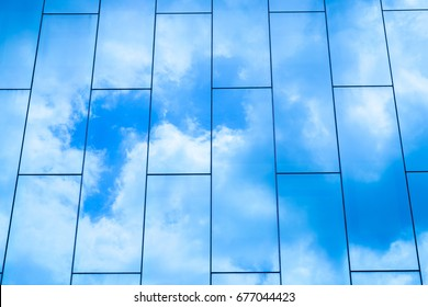 The cloud reflected in the window glass of the building.The cloud reflected in the window glass of the building.
