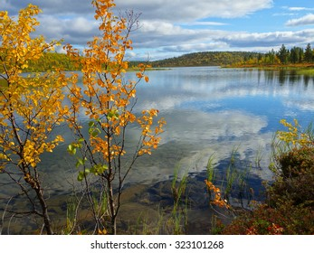 cloud reflection on a crystal clear lake, finnish lapland