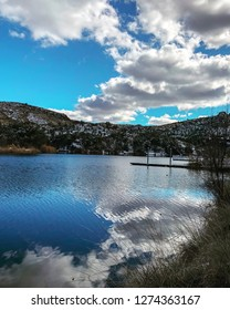 Cloud reflection with snow filled banks at Pena Blanca Lake in southern Arizona near the Mexico border.