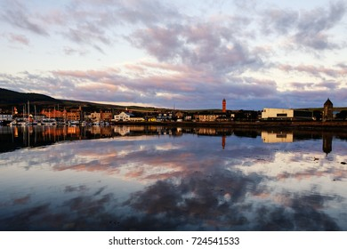 Cloud reflections on a calm morning at Campbeltown Harbour, Kintyre Peninsula, Scotland