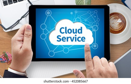 Cloud Service (Cloud Computing diagram on the new computer interface) businessman work on white broad, top view, on the tablet pc screen held by businessman hands - online, top view