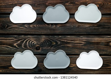 cloud service concept with clouds on wooden background top view mockup