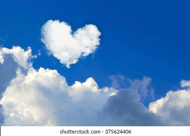 cloud shaped heart on  blue sky. Love background