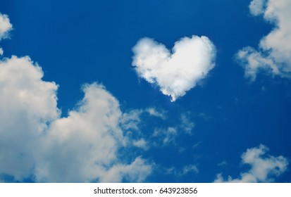 Cloud shaped heart on blue sky, and white clound