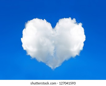 cloud shaped heart in the perfect blue sky. Valentine's Day concept