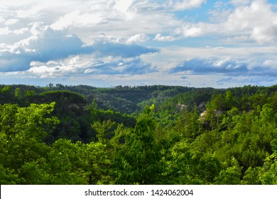 Cloud skys give way to sun over Red River Gorge