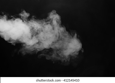Cloud of smoke on black background. Selective focus.