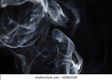 Cloud of smoke on black background