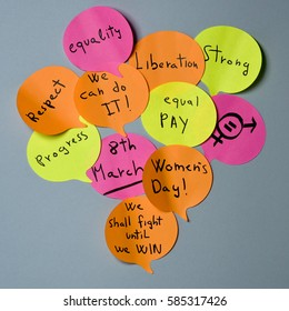 a cloud of sticky notes of different colors in the shape of speech balloons with concepts relative to the womens day written in it, such as equality respect, progress, liberation or equal pay