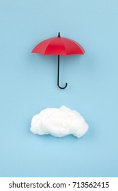 cloud under the red umbrella on sky blue background