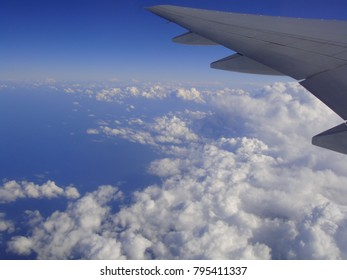 cloud view from airplane window. horizon and landscape form window seat