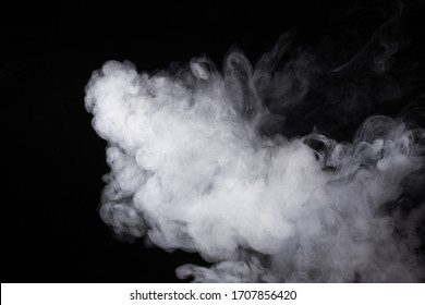 Cloud of white smoke on a black background closeup