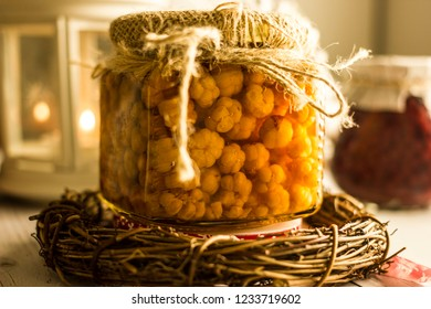 Cloudberry berry in a glass jar. Cloudberry jam. Northern berry of yellow color in a glass jar. Juicy ripe cloudberry.Wild berry jam cloudberry in a beautiful old-style bank