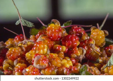 cloudberry, wild berries, North, wooden spoon, on stone,