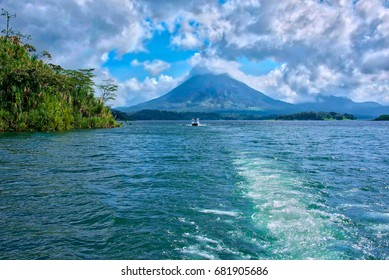 Cloud-covered Arenal Volcano in Costa Rica's Arenal National Park, as seen from a boat on Lake Arenal