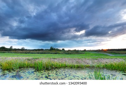clouded rainy weather over countryside in summer