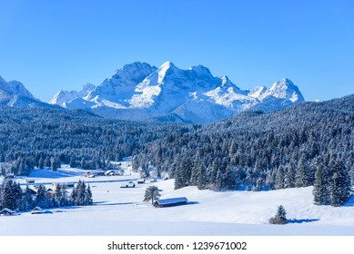 cloudless sky and fresh snow in bavarian alps with Zugspitze in background